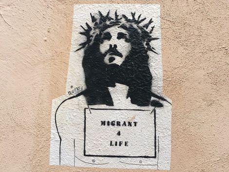 """Migrant 4 life"" Jesus graffiti in Rome, Italy."
